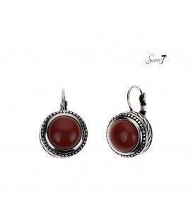 Rood bruine ronde oorbellen met Zilverkleurige bewerkte rand