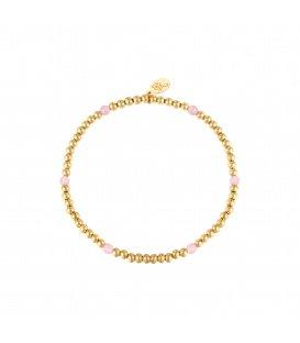 Elastische armband met goudkleurige kralen en zes roze kralen