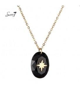 Goudkleurige ketting met zwarte steen met een ster