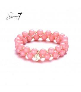 Armbanden met grote en kleine roze kralen