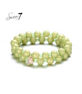 Armbanden met grote en kleine groene kralen