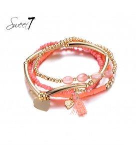 Set van armbanden met goudkleurige en rode kraaltjes en een kwastje