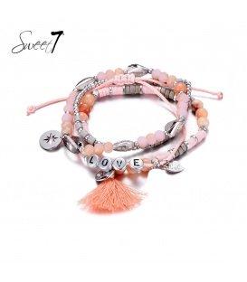 Set van armbanden met roze kraaltjes en 'love'