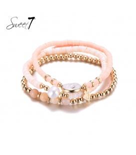 Set van drie armbanden met goudkleurige en roze kralen