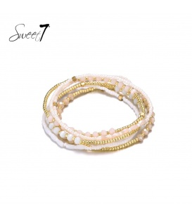 Wikkelarmband met kleine witte en goudkleurige kraaltjes