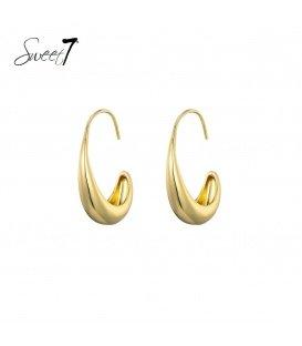 Goudkleurige ronde oorstekers die breder uitlopen