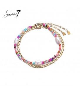 Enkelbandje met goudkleurige schakels en parels met roze kraaltjes