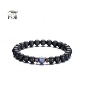 Elastische armband met zwarte kralen en een gekleurde kraal
