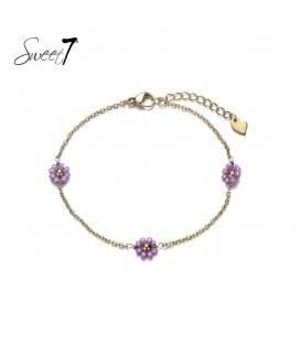 Goudkleurig enkelbandje met drie paarse bloemetjes