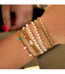 Armband met goudkleurige en parel kralen