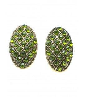 Mooie ovale goudkleurige oorclips met groene strass steentjes